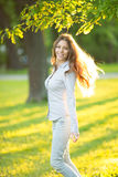 Romantic young girl outdoors enjoying nature Beautiful Model in Royalty Free Stock Image