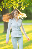 Romantic young girl outdoors enjoying nature Beautiful Model in Stock Photography