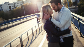 Romantic young happy couple kissing and hugging. Outside Royalty Free Stock Photography