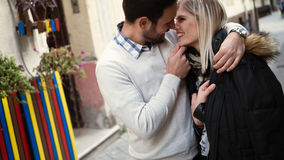 Romantic young happy couple kissing and hugging. Outside Royalty Free Stock Photo
