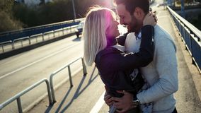 Romantic young happy couple kissing and hugging. Outside Royalty Free Stock Images
