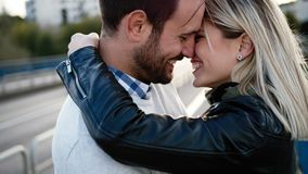 Romantic young happy couple kissing and hugging. Outside Stock Photo