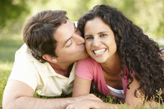 Romantic Young Hispanic Couple Relaxing In Park Royalty Free Stock Image