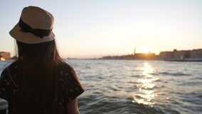 Romantic young lady enjoying Venice sunset alone on board of vaporetto water bus. Stock footage stock video footage