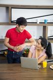Romantic Young lovely couple drinking orange juice and eat sandwich in the kitchen stock photo