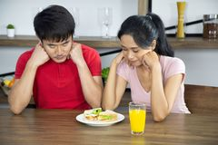 Romantic Young lovely couple show sandwich in the kitchen stock photo