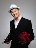 Romantic young man with flowers on a date Royalty Free Stock Photos