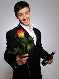 Romantic young man with flowers on a date stock photos