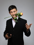 Romantic young man with flowers on a date Royalty Free Stock Image