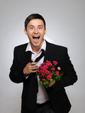 Romantic young man with flowers on a date Royalty Free Stock Photo