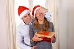 Romantic Young man giving christmas present Royalty Free Stock Image