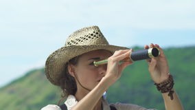 Romantic Young Travel Girl Looks At Spyglass stock footage