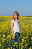 Romantic young woman, blonde, with flying hair, poses in a field Stock Image