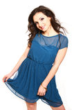 Romantic young woman in a blue dress posing on a white backgroun Stock Images