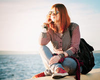 Romantic  young woman with handbag over seascape Royalty Free Stock Photos