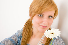 Romantic young woman hold gerbera daisy Royalty Free Stock Photos