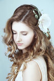 Romantic young woman with long curly blond hair Stock Photography