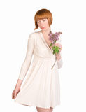 Romantic young woman in pastel dress with a lilac and modest look Royalty Free Stock Images