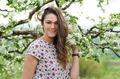 Romantic young woman portrait in blooming spring season Royalty Free Stock Photography