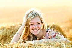 Romantic young woman posing outdoor. Stock Photos