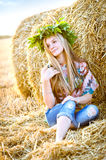 Romantic young woman posing outdoor. Royalty Free Stock Image