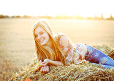 Romantic young woman posing outdoor. Royalty Free Stock Images