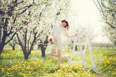 Romantic young woman in the spring garden Royalty Free Stock Photos