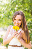 Romantic young woman in the spring garden among apple blossom, soft focus Royalty Free Stock Images