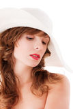 Romantic young woman in white straw hat Stock Photo