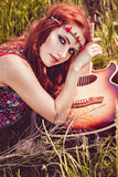 Romantic youth girl travelling with her guitar. Hippie style. Royalty Free Stock Photography
