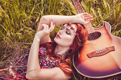 Romantic youth girl travelling with her guitar Stock Photography