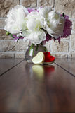Romantically bouquet of peony roses and a heart box Stock Photo