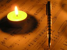 Romanticism. Candle of the note and the handle. It was photographed at night Stock Photo