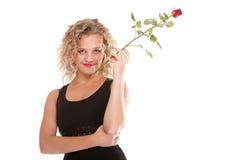 Romantico biondo della bella giovane donna è aumentato Fotografie Stock