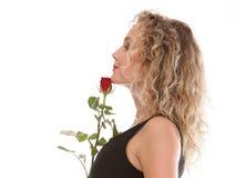 Romantico biondo della bella giovane donna è aumentato Fotografia Stock