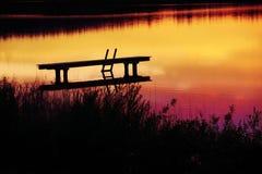 Romantische Landschaft mit Promenade bei Sonnenuntergang Lizenzfreies Stockfoto