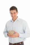 Romantische mens met een geweven hart van takjes die in zijn handen worden gehouden Stock Afbeelding
