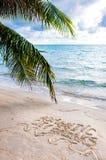 Romantische Städtereisemitteilung geschrieben auf Sand Stockfotografie