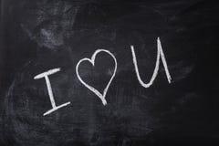 Romantische tekst met de hand geschreven op bord met krijt Stock Afbeeldingen