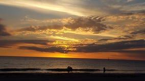 Romantisk afton på stranden Arkivbild