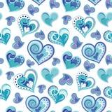 Romantisk sömlös modell med färgrika handattraktionhjärtor Blåa hjärtor på vit bakgrund också vektor för coreldrawillustration Royaltyfria Foton