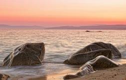 Romantisk solnedgång i Grekland Arkivbilder