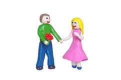 Romantiska par på ett datum från lera Arkivfoton