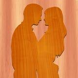 Romantiska par som göras med trä Arkivfoto