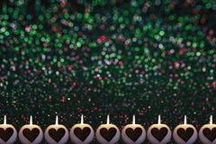 Romantyczny kolorowy Bożenarodzeniowy tło z świeczkami zdjęcia royalty free