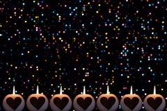 Romantyczny kolorowy Bożenarodzeniowy tło z świeczkami obraz stock
