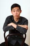 Romantyczny młody Azjatycki mężczyzna obsiadanie na krześle obrazy royalty free