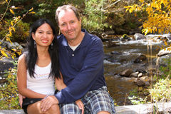 Romatic Couple sitting by a Stream Stock Photography