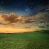Romatic evening. Beautiful sunset with a green meadow Royalty Free Stock Photography