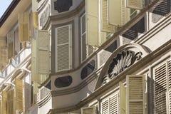 Romatic housing facades in Bozen Bolzano, Northern Italy. Typical romatic housing facades with open and closed shutters in Bozen, Northern Italy, Europe royalty free stock photography